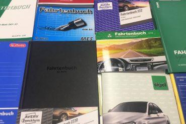 Cover von handschriftlichen Fahrtenbüchern.
