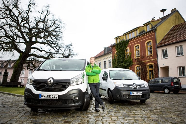 A vehicle fleet manager with his fleet