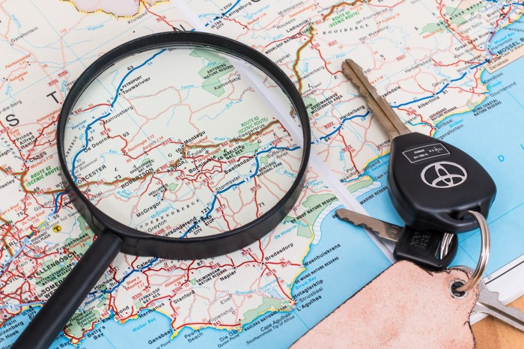 Map, keys and a magnifying glass