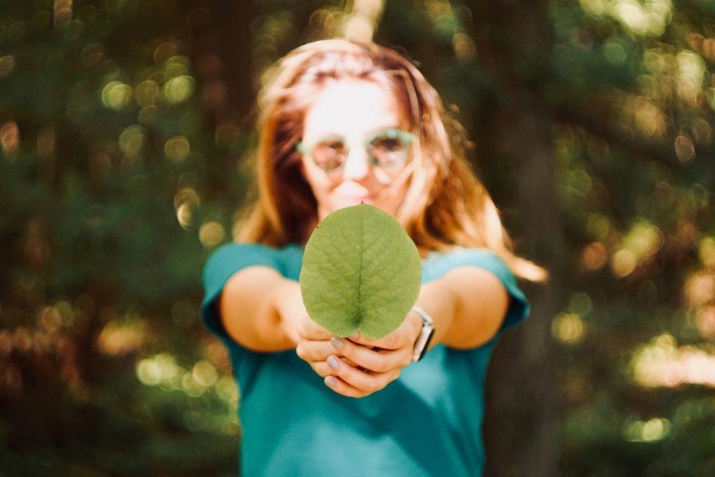 A woman holding a leaf