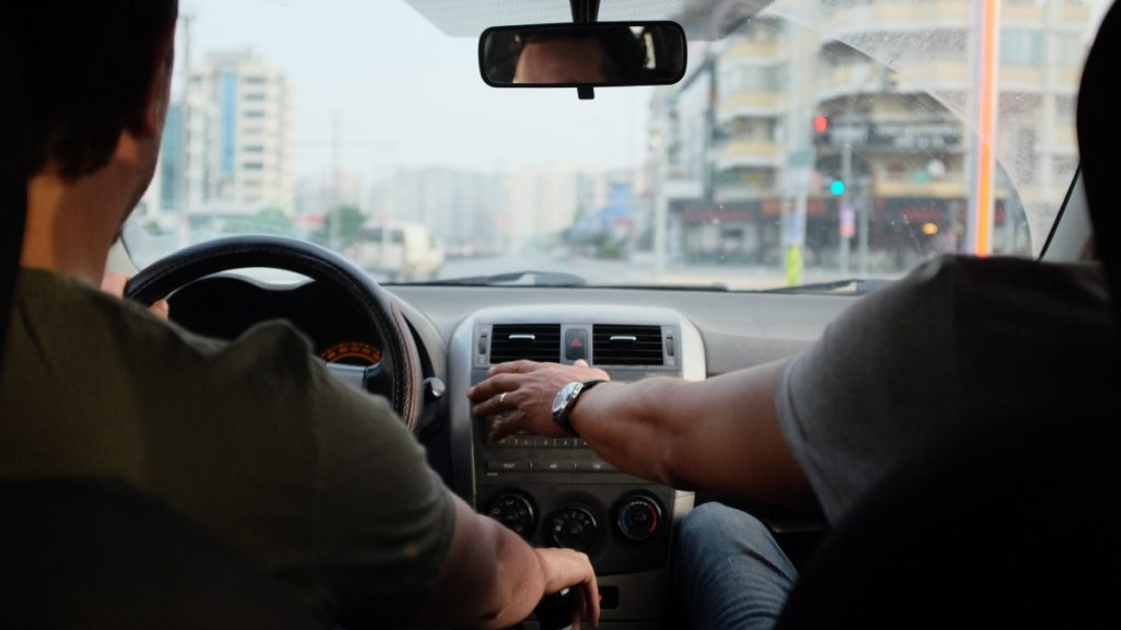 A driver and a passenger, talking about mileage logs.