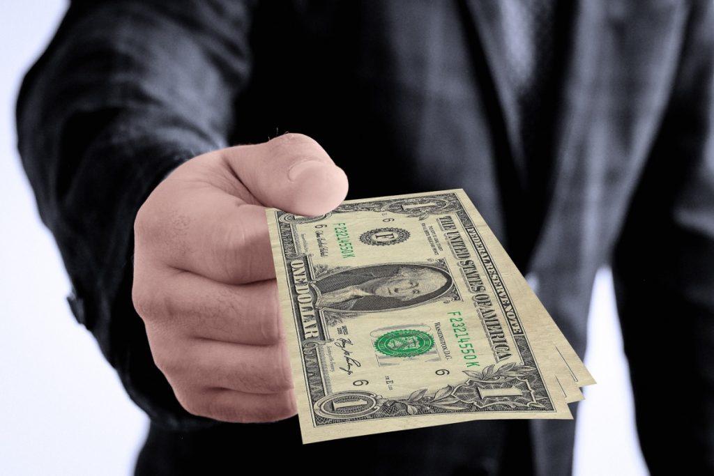 Hand with money