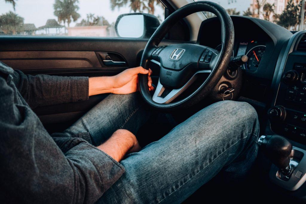 Man at the steering wheel, calculating his fleet TCO