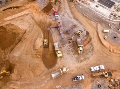 overhead shot of construction vehicles tracked at job site