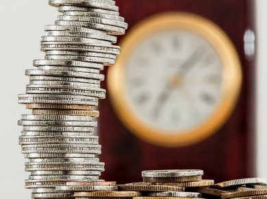 stack of coins clock in bakcground calculating company car tax