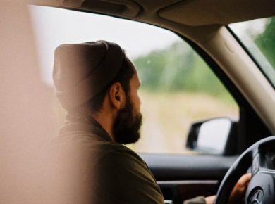 man driving grey fleet vehicle