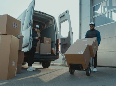 unloading delivery truck with tracker device for cars