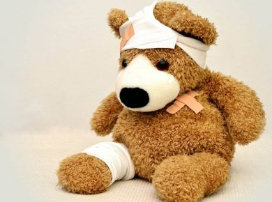 teddy bear covered in band aids