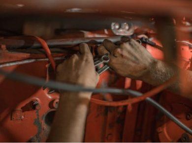 mechanic working on car following BVRLA fair wear and tear guide