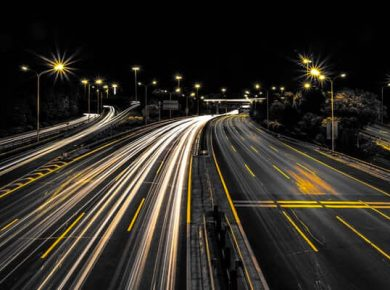 timelapse business vehciels on road at night