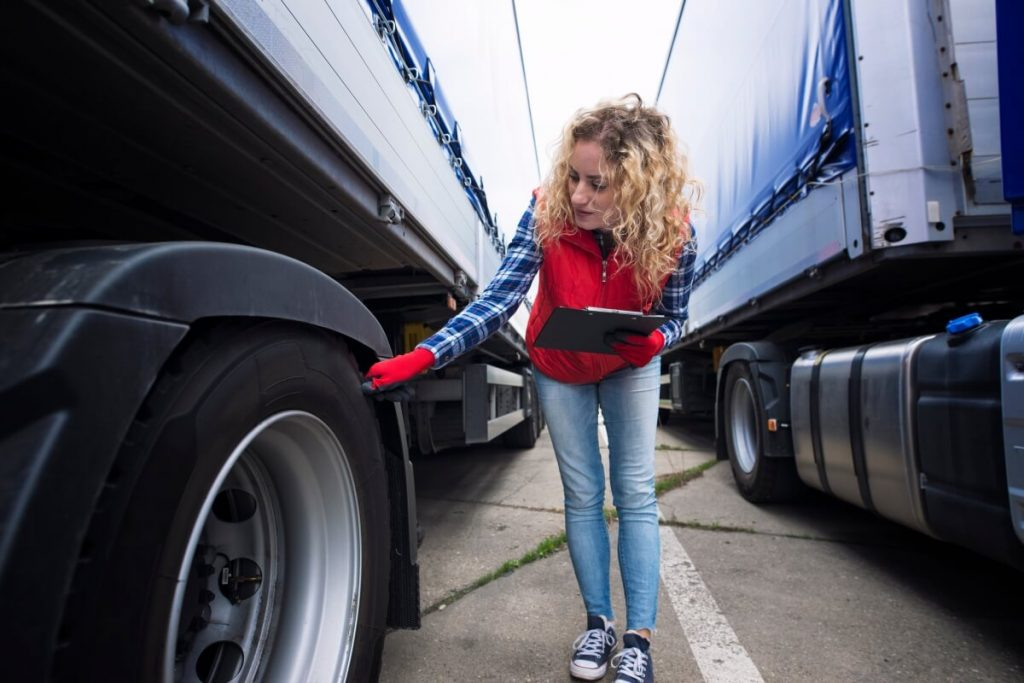 fleet manager performing fleet truck HSE vehicle checks and safety