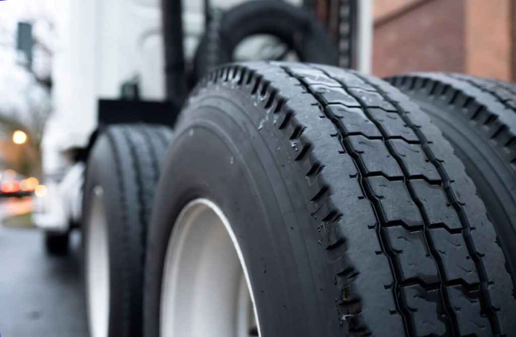 truck tires being checked must follow driving at work policy