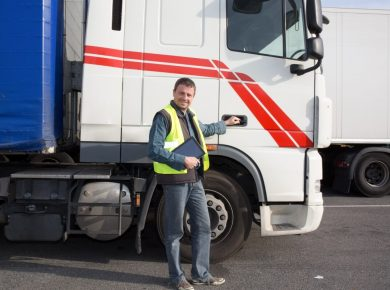 driver standing outside of long haul truck following driver rest laws