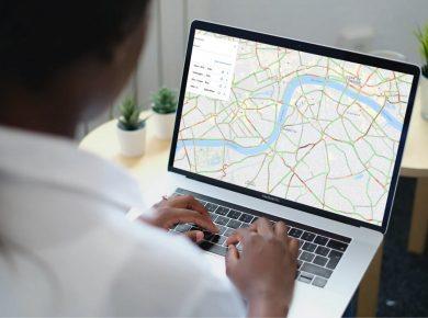woman using car telematics on laptop, gps tracking