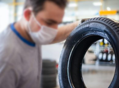 Man holding low rolling resistance tyres