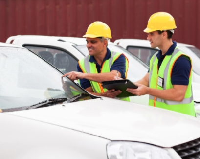 construction workers checking p11d for cars