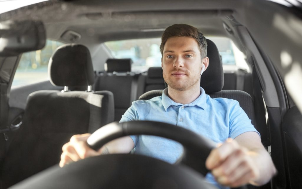 Driver driving a car and using a timesheet