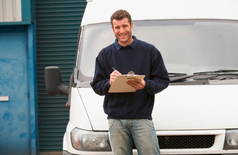 Employee using a van damage check sheet template